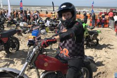racing-gloves-at-the-beach-scaled
