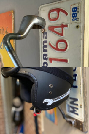 Handmade Helmet Hanger – A wrench on a board keeps your helmet safely stored